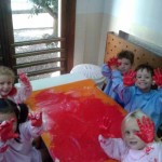 Busy Bees painting with their hands